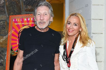 "Musician Roger Waters, left, and Laurie Durning arrive at the Hamptons Sneak Screening of Open Road Films' ""Rock the Kasbah"" on in East Hampton, N.Y"