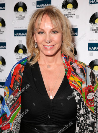 Lea Black arrives at the Distortion of Sound documentary premiere presented by Harman at the Grammy Museum, in Los Angeles