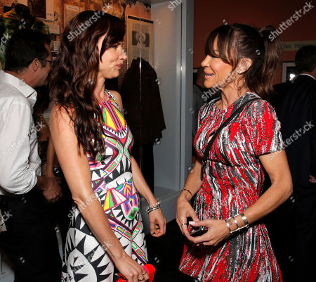 Juliette Lewis, left, and Robin Antin arrive at the Distortion of Sound documentary premiere presented by Harman at the Grammy Museum, in Los Angeles