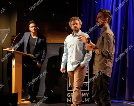 From left, Mario Lopez, Jacob Rosenberg, and Mike Shinoda speak at the Distortion of Sound documentary premiere presented by Harman at the Grammy Museum, in Los Angeles