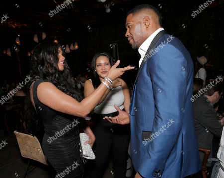 Sandy Denton, Cheryl James and Michael Strahan attend a private dinner hosted by Hennessy V.S.O.P Privilege and LL COOL J at Hinoki and the Bird in celebration of Music's Biggest Night on Saturday, February 7, in Los Angeles