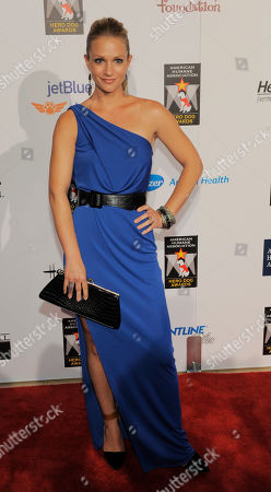 Actress AJ Cook poses at the Hero Dog Awards at the Beverly Hilton Hotel, in Beverly Hills, Calif. The event honored America's most courageous canines