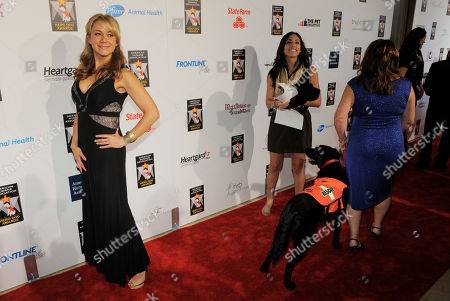 Actress Megyn Price, left, poses at the Hero Dog Awards at the Beverly Hilton Hotel, in Beverly Hills, Calif. The event honored America's most courageous canines