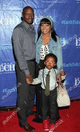 """From left: Forrest Martin, actress Paula Jai Parker and her son Onederful Vanglorious Jaxon N'Krumah Martin seen at Holly Robinson Peete's Screening of Relativity's """"Earth To Echo"""" Benefiting the HollyRod Foundation at Pacific Theatres at the Grove, in Los Angeles, California"""