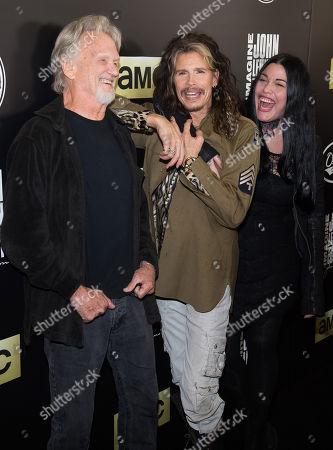 Kris Kristofferson, left, Steven Tyler and Mia Tyler attend the Imagine: John Lennon 75th Birthday Concert at Madison Square Garden, in New York