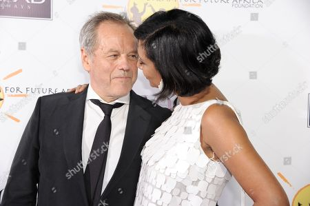 Stock Photo of Wolfgang Puck, left, and Gelila Puck arrive at the inaugural Dream for Future Africa Foundation Gala at Spago on in Beverly Hills, Calif