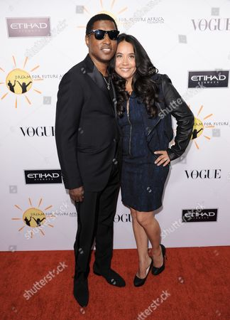 Kenneth Edmonds, left, and Nicole Pantenburg arrive at the inaugural Dream for Future Africa Foundation Gala at Spago on in Beverly Hills, Calif