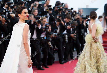 Stock Photo of Cansu Dere and Sonam Kapoor pose for photographers upon arrival for the screening of the film Inside Out at the 68th international film festival, Cannes, southern France