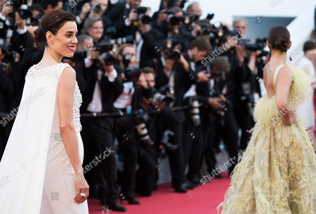 Cansu Dere and Sonam Kapoor pose for photographers upon arrival for the screening of the film Inside Out at the 68th international film festival, Cannes, southern France