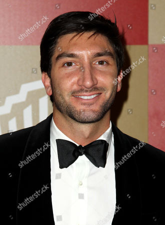 Evan Lysacek arrives at the InStyle and Warner Bros. Golden Globe After Party at the Beverly Hilton Hotel, in Beverly Hills, Calif