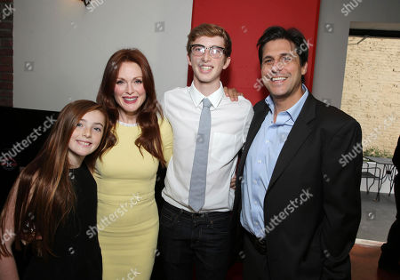 EXCLUSIVE CONTENT - PREMIUM RATES APPLY Liv Freundlich, Julianne Moore, Caleb Freundlich and MGM's Jonathan Glickman at Julianne Moore's Star Ceremony on the Hollywood Walk of Fame, on Thursday, Oct, 3, 2013 in Hollywood