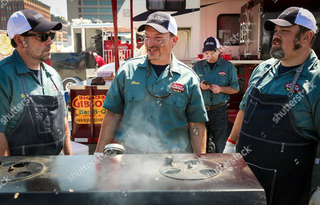 """Big Bob Gibson Bar-B-Q team led by Chris Lilly (center) from Decatur, Ala., prepares its """"Pick Your Pork"""" entry during the Kingsford Invitational on at Hudson River Park's Pier 26, New York"""