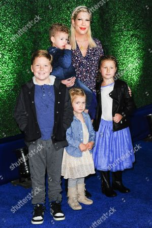 Tori Spelling with her children, from left, Liam Aaron McDermott, Finn Davey McDermott, Hattie Margaret McDermott, and Stella Doreen McDermott, arrive at Knott's Berry Farm Launches Voyage To The Iron Reef, in Buena Park, Calif