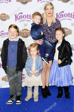 Tori Spelling with her children Liam Aaron McDermott, Finn Davey McDermott, Hattie Margaret McDermott, and Stella Doreen McDermott arrive at Knott's Berry Farm Launches Voyage To The Iron Reef, in Buena Park, Calif