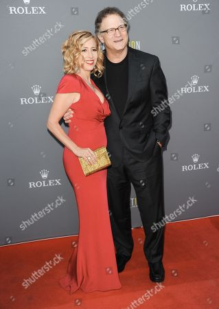 Kimberly Shlain, left, and Albert Brooks arrive at the LA Philharmonicâ?™s Walt Disney Hall 10th Anniversary Celebration at Walt Disney Concert Hall on in Los Angeles