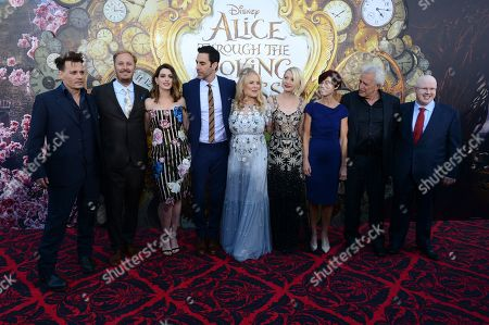 "Johnny Depp, director James Bobin, Anne Hathaway, Sacha Baron Cohen, producer Suzanne Todd, Mia Wasikowska, screenwriter Linda Woolverton, producer Joe Roth and Matt Lucas arrive at the premiere of ""Alice Through the Looking Glass"" at the El Capitan Theatre, in Los Angeles"