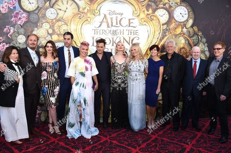 "Costume designer Colleen Atwood, from left, director James Bobin, Anne Hathaway, Sacha Baron Cohen, Pink, Johnny Depp, Mia Wasikowska, producer Suzanne Todd, screenwriter Linda Woolverton, producer Joe Roth, Matt Lucas and Danny Elfman arrive at the premiere of ""Alice Through the Looking Glass"" at the El Capitan Theatre, in Los Angeles"