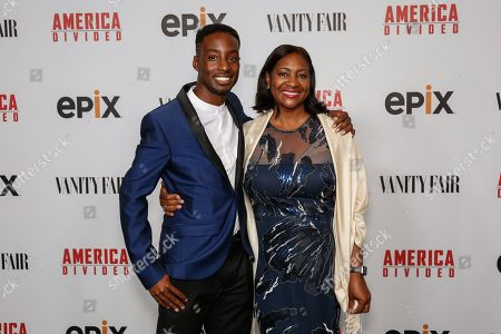 "Justin Talley, left, and Lajun Montgomery Tabron arrive at the LA Premiere of ""America Divided"" at The Billy Wilder Theater, in Westwood, Calif"