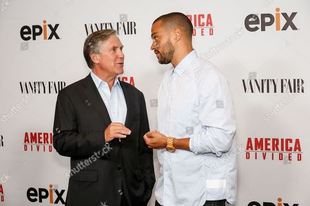 "Mark S. Greenberg, left, and Jesse Williams arrive at the LA Premiere of ""America Divided"" at The Billy Wilder Theater, in Westwood, Calif"