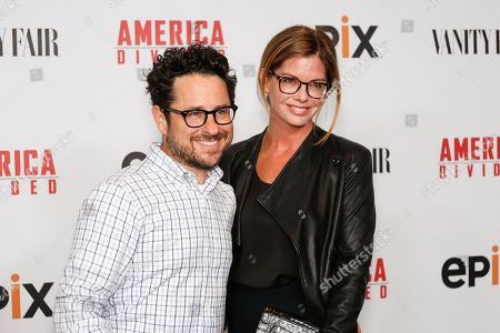 "Director and Producer J.J. Abrams, left, and wife Katie McGrath arrive at the LA Premiere of ""America Divided"" at The Billy Wilder Theater, in Westwood, Calif"