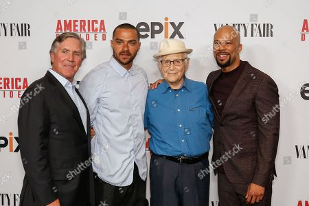 "Stock Photo of Mark S. Greenberg, from left, Jesse Williams, Norman Lear, and Common arrive at the LA Premiere of ""America Divided"" at The Billy Wilder Theater, in Westwood, Calif"
