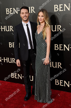 "Jack Huston, left, the star of ""Ben-Hur,"" poses with partner Shannan Click at the premiere of the film at the TCL Chinese Theatre IMAX, in Los Angeles"