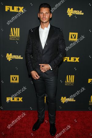 """Director/producer Vlad Yudin arrives at the premiere of """"Generation Iron"""" at the Chinese 6 Theatres on in Los Angeles"""