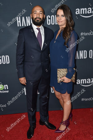 """Maximiliano Hernandez, left, and Holly Eve arrive at the Premiere of """"Hand of God"""" held at the Ace Hotel, in Los Angeles"""