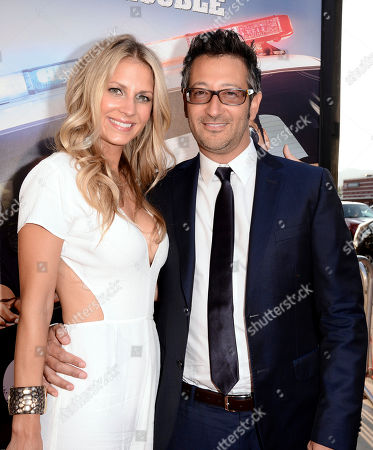 Writer/director Luke Greenfield, right, and Sarah Greenfield arrive at the Los Angeles premiere of 'Let's Be Cops' at the Cinerama Dome on