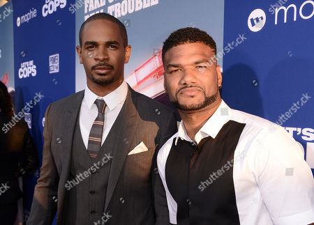 """Damon Wayans Jr., left, and Damien Dante Wayans arrive at the Los Angeles premiere of """"Let's Be Cops"""" at the Cinerama Dome on"""