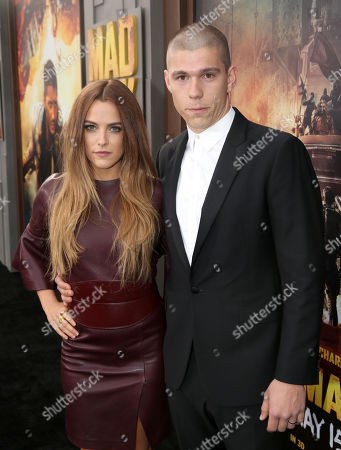 """Riley Keough, left, and Ben Smith-Petersen arrive at the Los Angeles premiere of """"Mad Max: Fury Road"""" at the TCL Chinese Theatre on"""