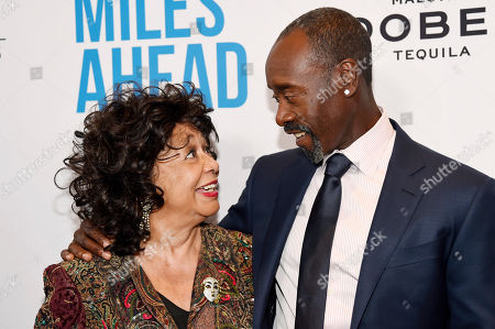 """Stock Picture of Don Cheadle, right, the star, director and co-screenwriter of """"Miles Ahead,"""" mingles with Frances Davis, ex-wife of legendary jazz trumpeter Miles Davis, at the premiere of the film at the Writers Guild Theatre, in Beverly Hills, Calif"""