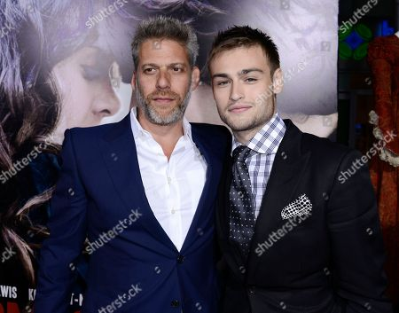 "Producer Lawrence Elman, left, and actor Douglas Booth arrive on the red carpet at the premiere of the feature film ""Romeo and Juliet"" at the ArcLight Hollywood on in Los Angeles"