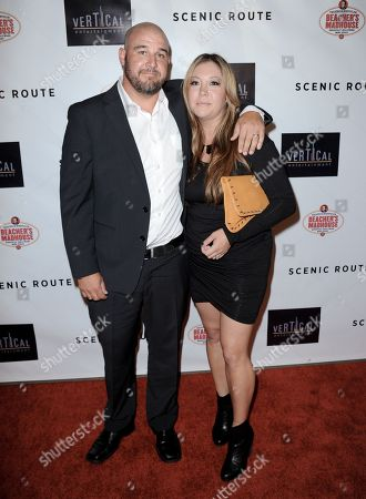 "Kevin Goetz, left, and Tracy Goetz arrive at the premiere of ""Scenic Route"" at the Chinese 6 Theater on in Los Angeles"