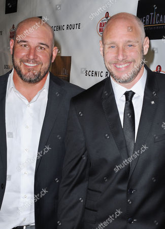 "Michael Goetz, at left, and Kevin Goetz arrive on the red carpet for the premiere of ""Scenic Route"" at the Chinese 6 Theater on in Los Angeles"