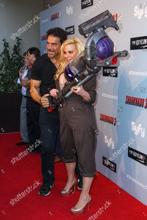 """Lou Ferrigno, left, and Cindy Margolis attend the """"Sharknado 3: Oh Hell No!"""" premiere at iPic Theaters Westwood on in Los Angeles"""