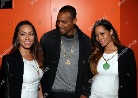 """Designers Sachika Twins and Duane Martin (C) seen at LA Premiere of """"Sister Code"""" at Universal Theaters AMC, in Universal City, California"""