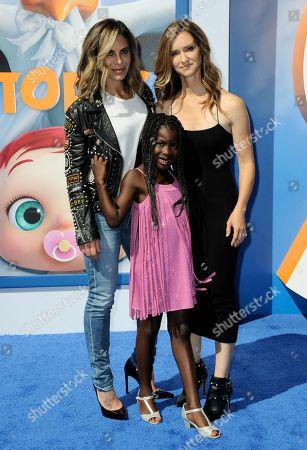 "Heidi Rhoades, Jillian Michaels and Lukensia Michaels Rhoades arrive at the LA premiere of ""Storks"" on in Westwood, Calif"