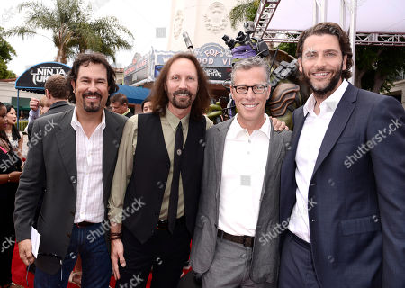"""Producers Galen Walker, and from left, Scott Mednick, Brad Fuller and Andrew Form arrive at the Los Angeles premiere of """"Teenage Mutant Ninja Turtles"""" at the Regency Village Theater on"""