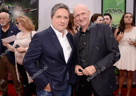 """Brad Grey, chairman and CEO of Paramount Pictures, and from left, producer Ian Bryce arrive at the Los Angeles premiere of """"Teenage Mutant Ninja Turtles"""" at the Regency Village Theater on"""