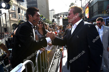 "Shinichi Shinohara and Arnold Schwarzenegger greet each other at the LA Premiere of ""Terminator Genisys"" at Dolby Theater on in Los Angeles"