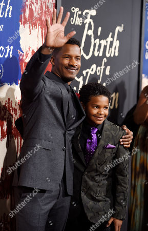 "Nate Parker, left, the director, screenwriter and star of ""The Birth of a Nation,"" poses with cast member Tony Espinosa at the premiere of the film at the Cinerama Dome, in Los Angeles"