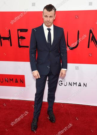 "Peter Franzen arrives at the Los Angeles premiere of ""The Gunman"" at Regal Cinemas LA LIVE on"