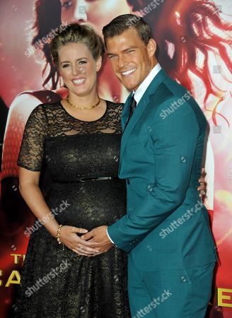 """Alan Ritchson, right, and Catherine Ritchson arrive at the Los Angeles premiere of """"The Hunger Games: Catching Fire"""" at Nokia Theatre LA Live on"""