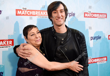 """Tina Grimmie, left, and Marcus Grimmie, the mother and brother of the late """"The Matchbreaker"""" cast member Christina Grimmie, embrace at the premiere of the film at the ArcLight Cinerama Dome, in Los Angeles. Grimmie, a singer on the television singing competition series """"The Voice,"""" was shot and killed while signing autographs and meeting fans following a concert in June in Orlando, Fla"""