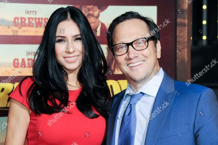 """Actor Rob Schneider, left, and Patricia Azarcoya attend the LA Premiere of """"The Ridiculous 6"""" held at AMC Universal Citywalk, in Universal City, Calif"""