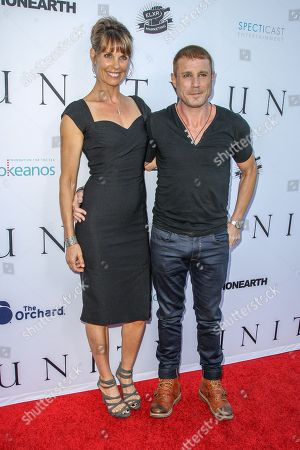Alexandra Paul and Jaason Simmons attend the world premiere of 'UNITY' at the DGA Theater on in Los Angeles