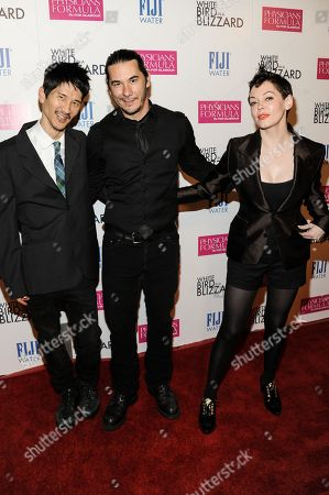 "Rose McGowan, left, Gregg Araki, center, and James Duval arrive at the LA Premiere of ""White Bird In A Blizzard"", in Los Angeles"