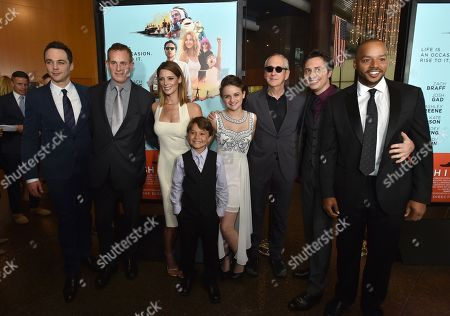 """Jim Parsons and from left, Peter Schlessel, CEO of Focus Features, Ashley Greene, Pierce Gagnon, Joey King, producer Michael Shamberg, Zach Braff and Donald Faison arrive at the Los Angeles premiere of """"Wish I Was Here"""" at the Directors Guild of America Theater on"""
