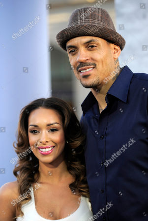 """Gloria Govan and Los Angeles Clippers' Matt Barnes pose together at the Los Angeles premiere of """"42"""" at the TCL Chinese Theater on in Los Angeles"""